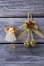 Beautiful little fairy and christmas golden bell. Royalty Free Stock Photo