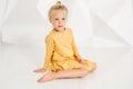 Beautiful little fashion model on white studio background. Portrait of cute girl posing in studio Royalty Free Stock Photo