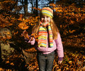 Beautiful little girl in autumn park pretty Royalty Free Stock Photos