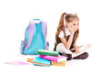 Beautiful little girl, books and a backpack Stock Photography