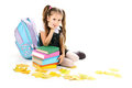 Beautiful little girl, books and a backpack Royalty Free Stock Photography
