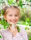 Beautiful little girl bush blossoming tree Royalty Free Stock Photography