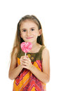 Beautiful little girl and candy on stick Royalty Free Stock Images