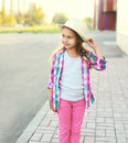 Beautiful little girl child wearing a pink checkered shirt and hat Royalty Free Stock Photo