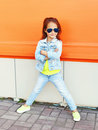 Beautiful little girl child wearing a sunglasses and jeans clothes Royalty Free Stock Photo