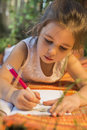 Beautiful little girl drawing outdoor Royalty Free Stock Photo