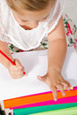 Beautiful  little girl  drawing with pencil Royalty Free Stock Images