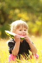 Beautiful little girl eating watermelon on the nature a Stock Photos