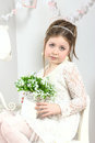 A beautiful little girl with flowers in a pot Royalty Free Stock Images