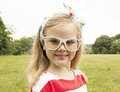 Beautiful little girl with glasses smiling in white Royalty Free Stock Photo
