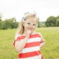 Beautiful little girl with glasses smiling in white Stock Images