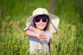A beautiful little girl with a hat in a grain fiel Royalty Free Stock Photography