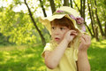 Beautiful little girl in a hat on the nature Royalty Free Stock Photos