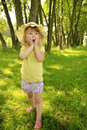 Beautiful little girl in a hat on the nature Royalty Free Stock Photo
