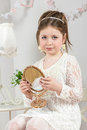 A beautiful little girl looking to small mirror Stock Images
