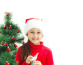 Beautiful little girl opens a Christmas gift Royalty Free Stock Photo