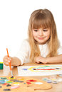 Beautiful little girl painting on white Stock Photography
