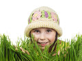 Beautiful little girl peeking out of the grass Royalty Free Stock Photo