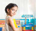 Beautiful little girl portrait latin in daycare Royalty Free Stock Photo