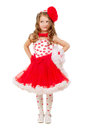 Beautiful little girl posing in red and white lace dress with big bow isolated Stock Photos