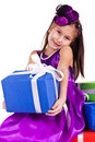 Beautiful little girl with presents Stock Image