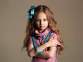 Beautiful little girl.pretty little lady in dress and flower in healthy hair Royalty Free Stock Photo