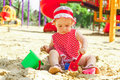 Beautiful little girl in red clothes, playing Royalty Free Stock Image