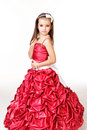 Beautiful little girl in red evening dress Royalty Free Stock Photos