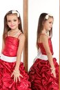 Beautiful little girl in red evening dress Stock Images