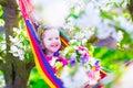 Beautiful little girl relaxing in a hammock Royalty Free Stock Photo