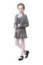 Beautiful little girl in school uniform isolated