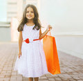 Beautiful little girl with shopping bag Royalty Free Stock Photo