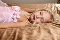 Beautiful little girl sleeping on bed Royalty Free Stock Photo