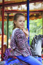 Beautiful little girl spinning on the carousel in park Royalty Free Stock Photos