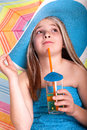 Beautiful little girl in summer hat drinking juice blue Stock Photography