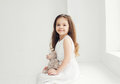 Beautiful little girl with teddy bear Royalty Free Stock Photo