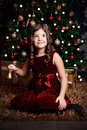 Beautiful little girl tinkle at christmas ringing the tinkler bell Royalty Free Stock Photo