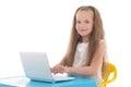 Beautiful little girl using laptop isolated on white background Stock Photos