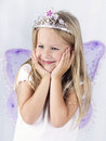 Beautiful little girl wearing diadem and butterfly wings Royalty Free Stock Photo