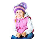 Beautiful little girl wearing a hat and jacket portrait of dressed in winter frost christmas Royalty Free Stock Photo