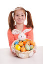 Beautiful little red-haired girl with pigtails holding Easter eg Stock Photo
