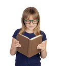 Beautiful little student with glasses reading a book isolated on white background Stock Photo
