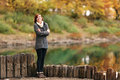 Beautiful lonely girl on the bank of  river Royalty Free Stock Photo