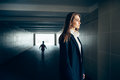 Beautiful lonely woman in subway tunnel with frighten silhouette Royalty Free Stock Photo