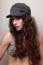 Beautiful long hair trendy woman in cap hip hop style Stock Photo