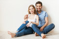 Beautiful loving couple young sitting on the floor at their apartment and smiling at camera Royalty Free Stock Photography