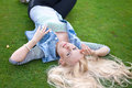 Beautiful lying on the green grass with untressed hair Royalty Free Stock Photo