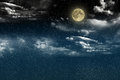 Beautiful magic blue night sky with clouds and fullmoon and stars Royalty Free Stock Photo