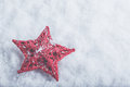 Beautiful magical vintage red star on a white snow background. Winter and Christmas concept Royalty Free Stock Photo
