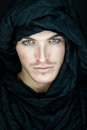 Beautiful man with black scarf eyes of a Royalty Free Stock Photography